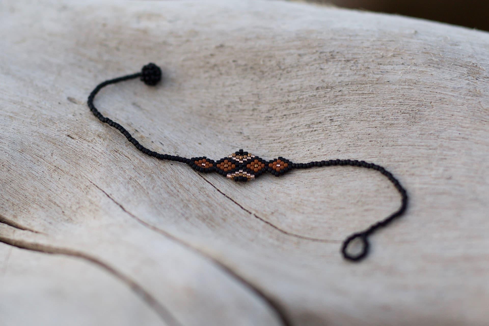 Tiama Handmade Beaded Bracelet | Black + Rust