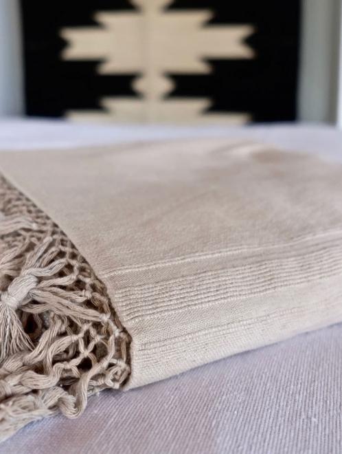Cotton tassel blanket in taupe