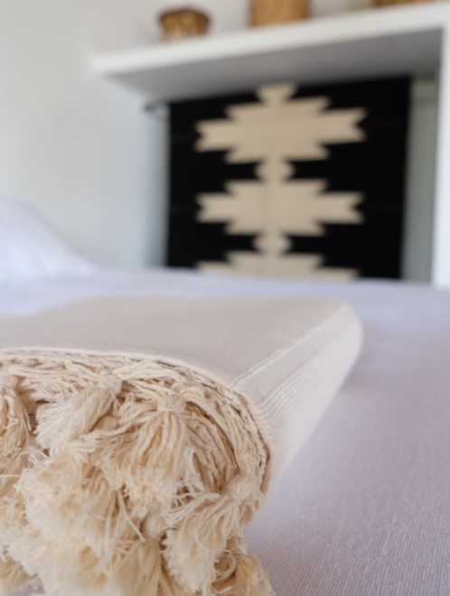 Woven Cotton tassel blanket in Natural