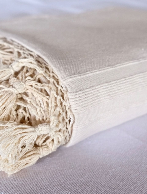 Woven Cotton tassel blanket in Natural